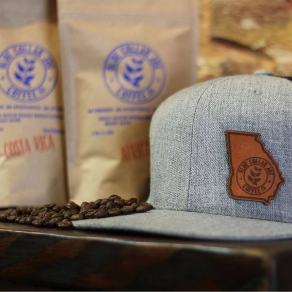 Hat with two coffee bags and beans